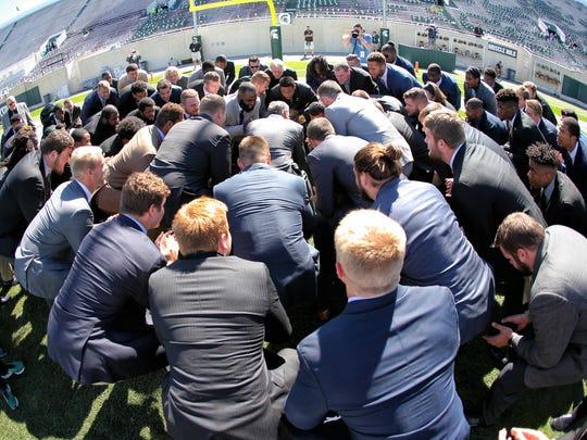 Sep 30, 2017; East Lansing, MI, USA; Michigan State head coach Mark Dantonio huddles with his team prior to a game against Iowa at Spartan Stadium.