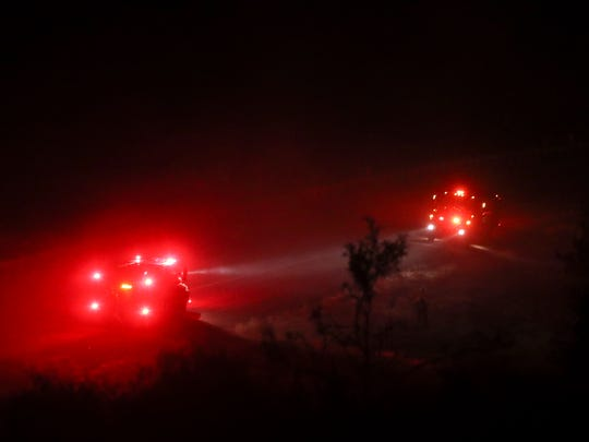 Fire crews work hot spots of the Klamathon Fire near Interstate 5, about 15 miles north of Yreka on Thursday.