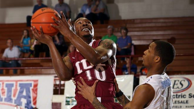 Vasha Davis of IU East (10) goes for a shot during the NAIA Men's Division II Basketball National tournament.