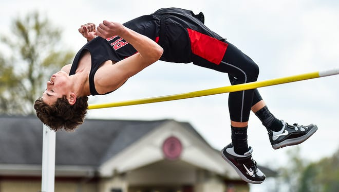 Pleasant's Jed Charpie cross the bar in the boys high jump Tuesday during the Marion County Track Meet at Pleasant. Charpie won the event at 6-foot-2.