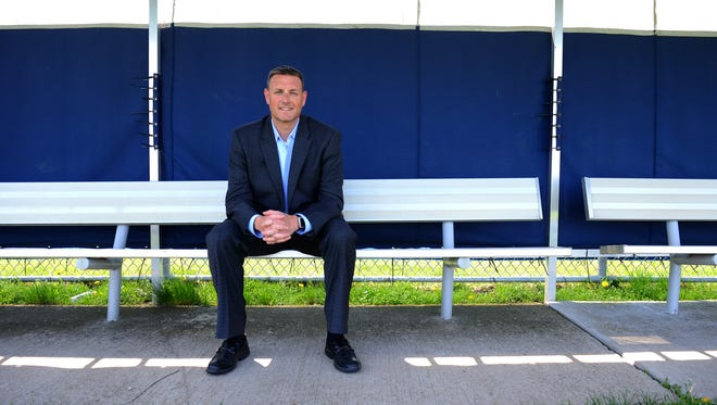 Lansing United President and CEO Jeremy Sampson  sits at the East Lansing Soccer Complex on Friday. Sampson and LanU are beginning their third season, a dizzying ride that began with an idea on a napkin.