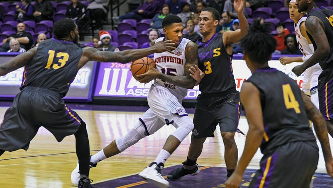 NSU's Malik Metoyer drives to the basket against LSUS.