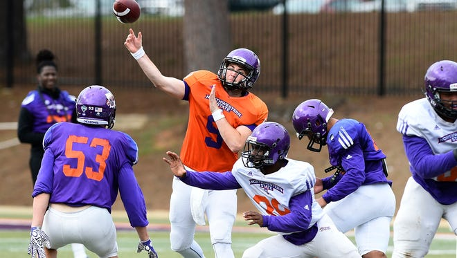 NSU quarterback Kenny Sears throws a pass during spring practice.