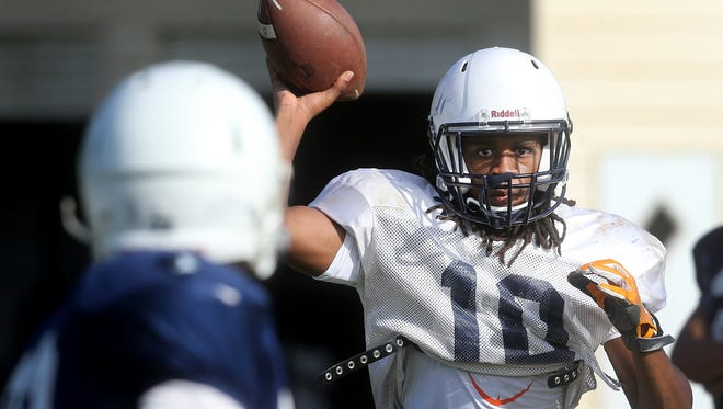 Blackman's Adonis Otey throws a pass during spring practice. Otey decommitted from Tennessee on Monday.