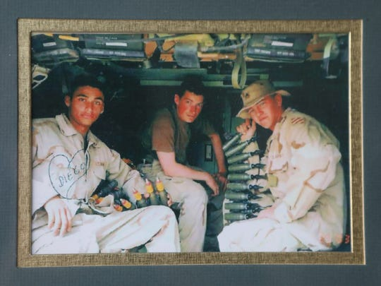 Cpl. Michael Curtin, center, with Diego Rincon, left, and Michael Creighton, right, fellow members of the Army's 3rd Infantry Division. All three were killed when a taxi driver flipped a switch and set off a massive bomb at a roadside checkpoint outside Najaf, Iraq, on March 29, 2003.