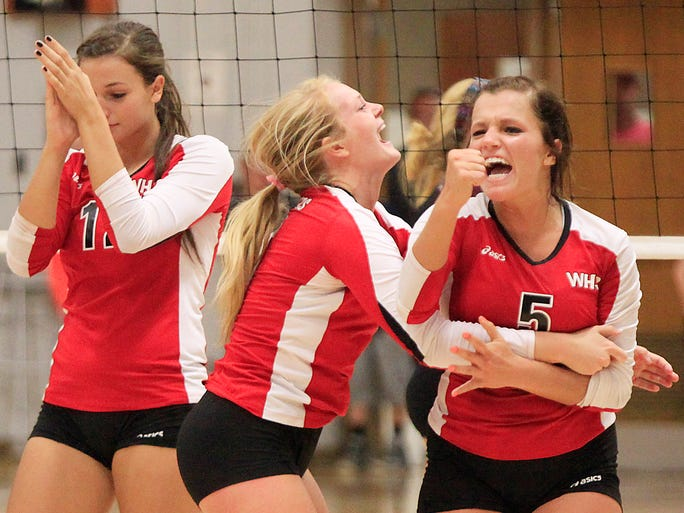 Wapahani celebrates the victory against Wes-Del in the final set Thursday evening during a match at Wes-Del High School. Wapahani won the match after a very close fourth set with a final score of 3-1.