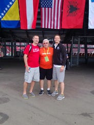 Bob Hutchings (center) poses with Student Athlete World