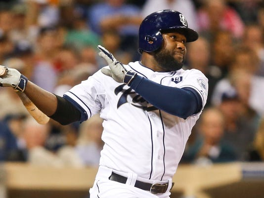San Diego Padres' Abraham Almonte drills a line drive to center field, scoring Tyson Ross from second in the third inning of a baseball game Tuesday, Aug. 26, 2014, in San Diego.  (AP Photo/Lenny Ignelzi)