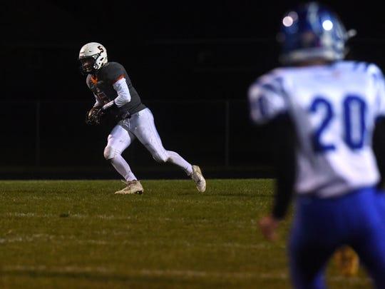 Lennox's Josh Arlt (5) runs the ball during a game