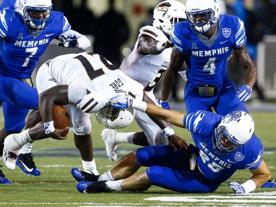 University of Memphis defender Austin Hall (right) brings down University of Louisiana-Monroe running back Derrick Gore (left) during third quarter action at the Liberty Bowl Memorial Stadium.