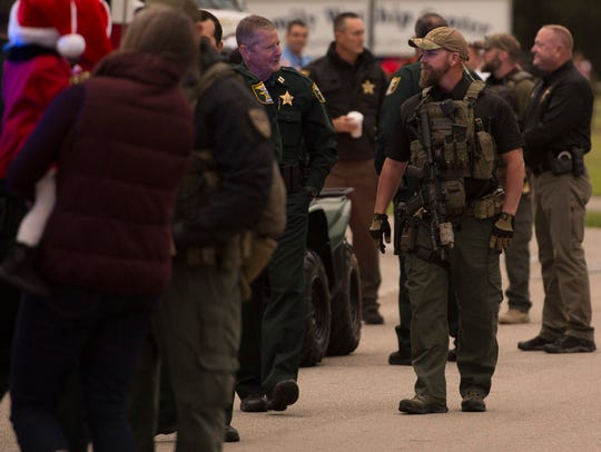 Law enforcement officers gather at the Indiantown Christmas