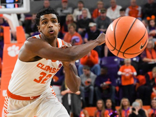 Clemson forward Donte Grantham (32) passes against Miami during the first half at Littlejohn Coliseum in Clemson on Saturday.