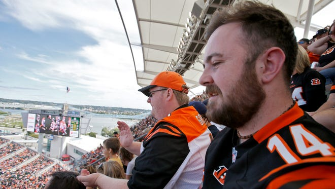 Matthew Catterall, right, and Jamie Wroe, middle, cheer for the Bengals on Sept. 20 at Paul Brown Stadium. The friends flew in from Manchester, England, for the game. It was Catterall's first trip to the United States.