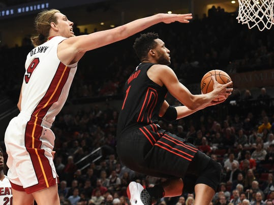 Portland Trail Blazers forward Evan Turner drives to the basket past Miami Heat forward Kelly Olynyk during the second half of an NBA basketball game in Portland, Ore., Monday, March 12, 2018. The Blazers won 115-99. (AP Photo/Steve Dykes)