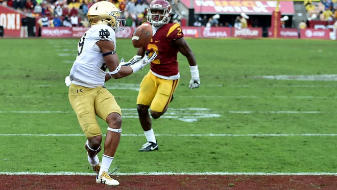 Nov 26, 2016; Los Angeles, CA, USA; Notre Dame Fighting Irish wide receiver Kevin Stepherson (29) catches a touchdown pass in front of USC Trojans cornerback Adoree Jackson (2) in the third quarter at the Los Angeles Memorial Coliseum. USC won 45-27. Mandatory Credit: Matt Cashore-USA TODAY Sports