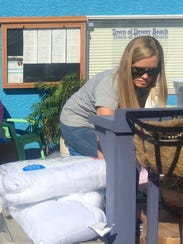 Ashleigh Hudson, of Rehoboth Beach, packs up a U-Haul