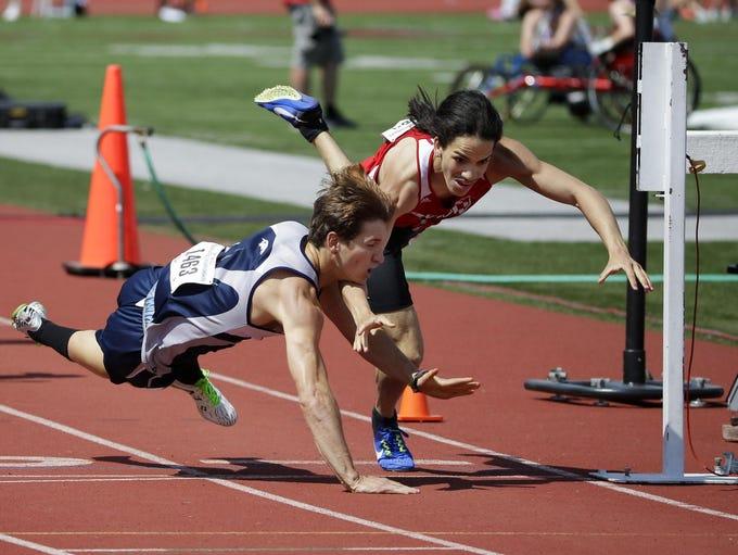 Xavier's Nathan Broullire, left, falls across the finish