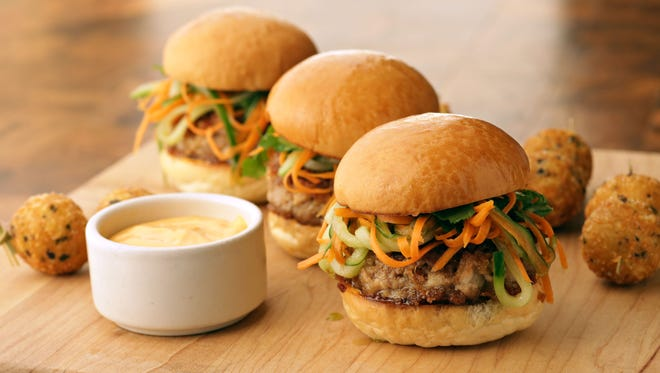 Crispy pork belly sliders with truffle fritters from Chef Jacques Qualin of J&G Steakhouse at the Phoenician as seen in Scottsdale on Jan. 6, 2015.