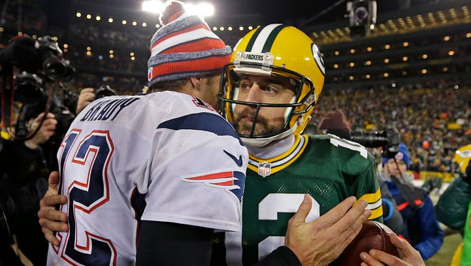 Patriots quarterback Tom Brady topped Packer quarterback in a recent quarterback poll by The Associated Press.