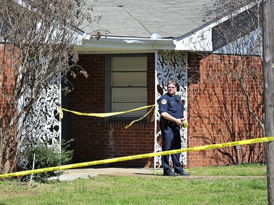 A police officer stands at an officer-involved shooting scene in Nashville on April 1, 2015.