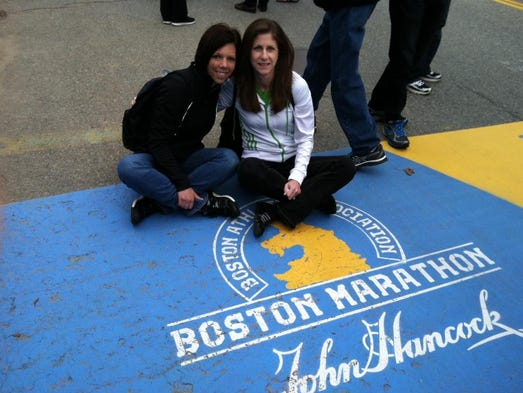 Runners Christine Antonini of Hilton and Kathy Champagne of Brockport at the Boston Marathon start line in 2013. The image was taken the day before the bombings.