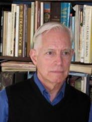 Michael Adas, teaching a Byrne Seminar on war in the