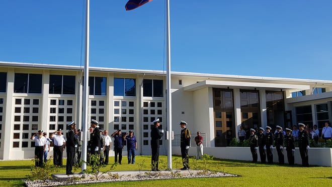 Vietnam veterans salute the flags during a flag raising ceremony in honor of them and their fallen brethren at the Guam Congress Building on Nov. 6, 2017.