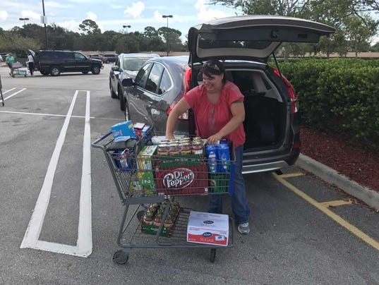 Rev. Michelle Dyar loads up on food at Sam's Club in Port St. Lucie