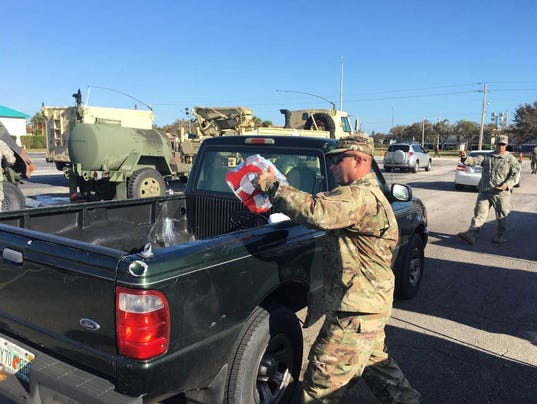National Guard distributes bottled water - 636408922064156457 water dist - National Guard distributes bottled water