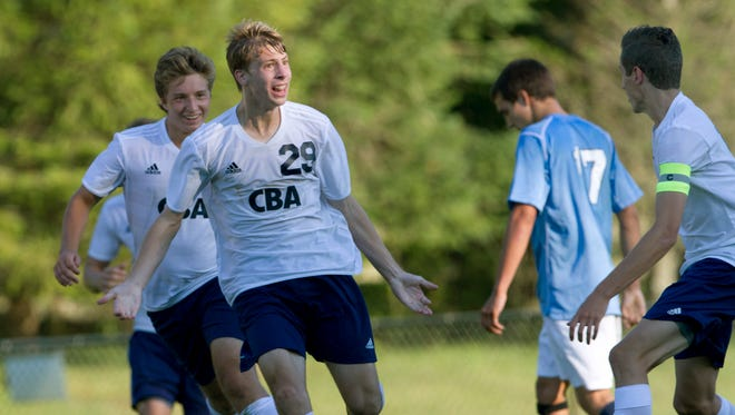 CBA's Matt Thorsheim celebtates with teammates after he scored the tying goal late in the second half. Freehold Township vs CBA Boys Soccer in Middletown on September 17, 2015