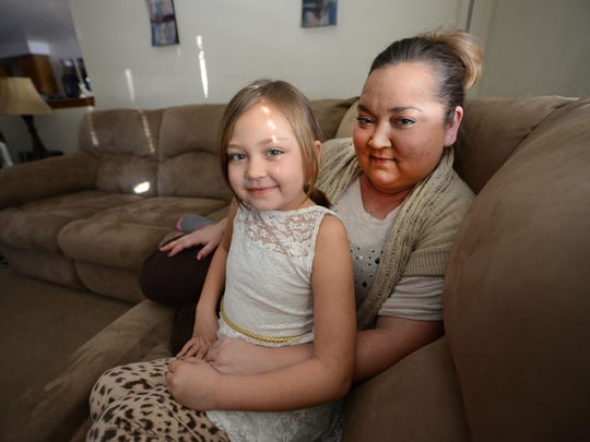 Mandy Chartier, right, and her daughter Emma at home