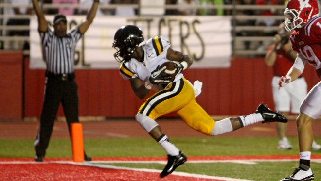 Neville Tiger Kavontae Turpin (4) leaps for the touchdown during the second quarter against the Ruston Bearcats.