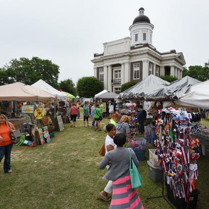The historic courthouse square bustled with activity