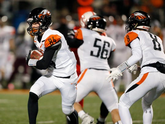 Cedar Rapids Prairie's Jace Andregg, left, runs the