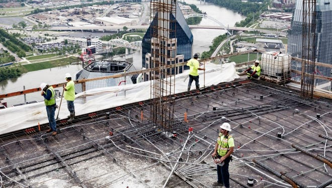 Workers on the 45th floor of 505, which is rising at the corner of Fifth and Church.