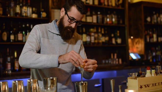 Managing partner Tony Oczus adds egg white to his shaker while making a Pisco Sour at Proof in De Pere. You'll find him behind the bar four days a week. He also owns the Libertine in downtown Green Bay.