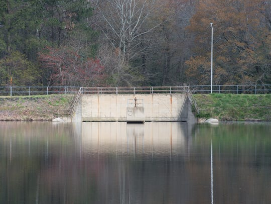 A view of the Schumaker Pond spillway on Thursday,