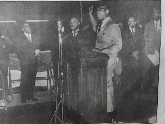 Dr. Martin Luther King, third from left, and Andrew Jackson White, far right, at an event at Virginia State University in the early 1960s.