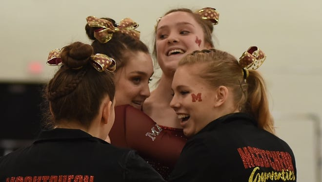 Girls from the McCutcheon gymnastics team celebrate Saturday at the Lafayette Jeff IHSAA gymnastics sectional.