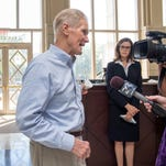 Judge Casey Rodgers looks on as Senator Bill Nelson talks with the press after touring the Federal Courthouse that has mold issues during a visit in Pensacola, FL on Monday, August 29, 2016.