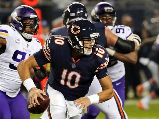 FILE - In this Oct. 9, 2017, file photo, Chicago Bears quarterback Mitchell Trubisky (10) scrambles during the first half of an NFL football game against the Minnesota Vikings in Chicago. Passed on in the draft by his hometown Browns, Trubisky will line up against them when the Bears host winless Cleveland on Sunday. (AP Photo/Charles Rex Arbogast, File)