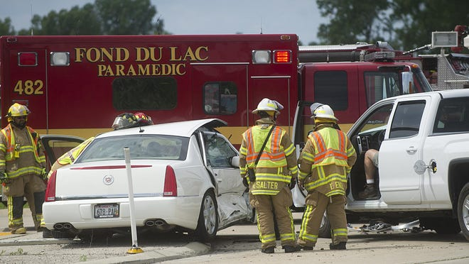Members of Fond du Lac Fire and Rescue and Eden Fire and Rescue respond to a two-vehicle crash Thursday afternoon, at the intersection of Highway 151 and Rienzi Road in Fond du Lac. The collision killed an elderly woman.