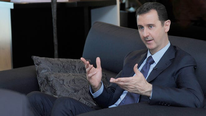 In this Aug. 26, 2013, photo released by the Syrian official news agency SANA, Syrian President Bashar Assad gestures as he speaks during an interview with a Russian newspaper in Damascus.