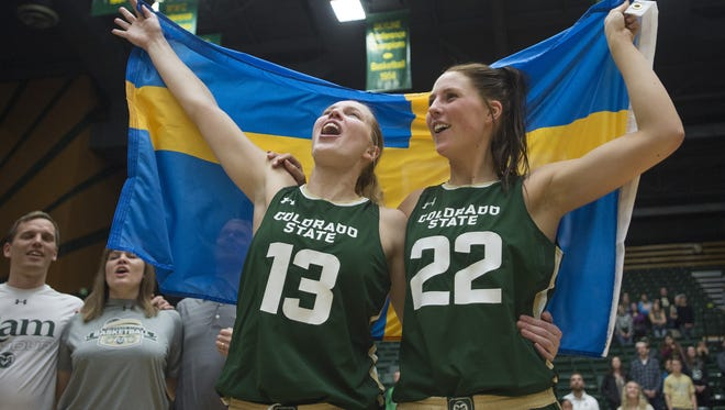 Ellen Nystrom and Elin Gustavsson celebrate with the Swedish flag following a 64-51 win over Nevada and being awarded the Mountain West Championship trophy in March 2017. The two seniors from Sweden won four MW regular season titles and won a total of 103 games in their storied CSU careers.