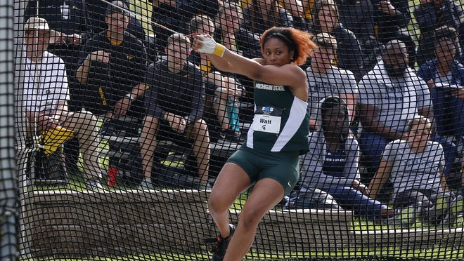 MSU's Cynthia Watt throws the hammer during the Big Ten championships Friday at MSU. Watt took the championship with a conference tournament record 65.03-meter throw.