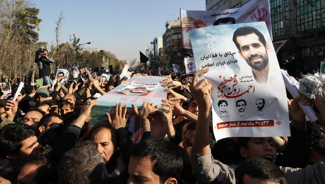 Mourners carry the coffin of Iranian nuclear scientist Mostafa Ahmadi Roshan during his funeral in Tehran on Jan. 13, 2012, one day after he was killed when two men on a motorbike slapped a magnetic bomb on his car while it was stuck in Tehran traffic.