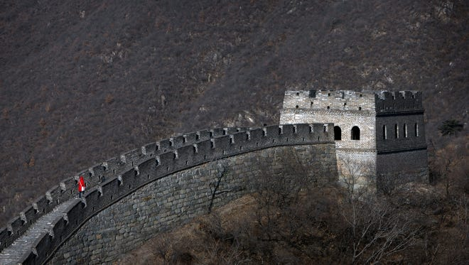 The visitor wearing red and walking on the Mutianyu section of the Great Wall on outskirts of Beijing could be you if you had a business relationship in China.