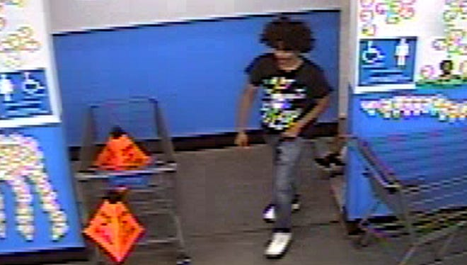 The Chandler Police Department is asking for the public's help to identify this man who is accused of robbing a couple outside a Red Robin restaurant before entering a Walmart on Oct. 15.