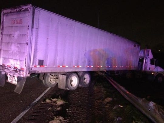 A mail truck crashed into a guard rail during icy conditions