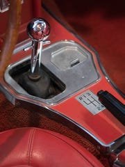 The chome shift lever shifts through the 4 gears.